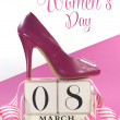 International Women's Day, March 8, vintage calendar and pink high heel shoe. — Stock Photo
