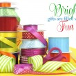Bright multi color gift wrapping ribbons and scissors with sample text — Stock Photo