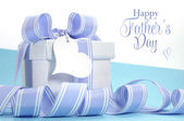 Blue Fathers Day gift with beautiful stripe ribbon — Stock Photo