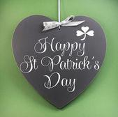 Happy St Patricks Day greeting on heart shape blackboard — Stock Photo