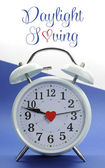 Vintage style white clock with Daylight Saving sample text — 图库照片