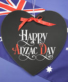 Happy Anzac Day, April 25, national public holiday celebration for returned soldiers, greeting on heart shaped blackboard — Stock Photo
