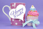 Happy Easter pink, yellow and blue cupcake fairy cakes. — Zdjęcie stockowe