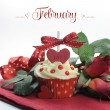 Beautiful cupcake with seasonal flowers and decorations for each month of the year sample text — Stock Photo