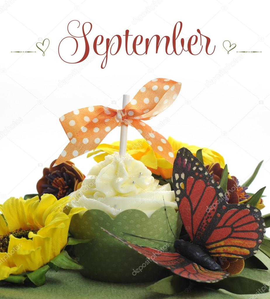 Beautiful Cupcake With Seasonal Flowers And Decorations For Each Month Of The Year Sample Text Stock Image