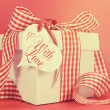 Retro vintage old fashion style red and white check gift box — Stock Photo #41828807