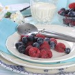 Beautiful cupcake and berries on vintage blue tray — Stock Photo