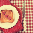 Retro vintage style red check table setting with polka dot plate and knife and toast with hearts — Foto Stock
