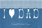 Happy Fathers Day letters, I heart Dad, bunting hanging from peg — Stock Photo