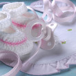Close up of baby girl nursery dummy pacifier and pink and white — Stock Photo