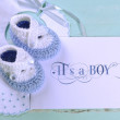 Baby boy nursery blue and white wool booties, bib and card with — Stock Photo #46324425