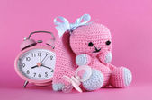 Baby girl nursery cute bunny toy, dummy pacifier and clock  — Stock Photo