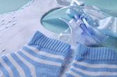 Baby boy nursery blue and white socks, bib and dummy pacifier, c — Stock Photo