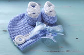 Baby boy nursery blue and white wool booties, dummy and pacifier — Stock Photo