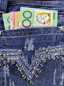 Australian money in back pocket of feminine ladies rhinestone de — Stock Photo