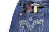 Female worker blue jeans with red lipstick and hammer. — Stock Photo