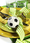 Soccer football party table in yellow and green team colors - cl — Stock Photo