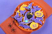 Happy Halloween purple and orange cookies — Stock Photo