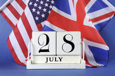 Vintage style white block calendar for 28 July, start of World War I, centenary, 1914 to 2014, with USA, stars and stripes, and UK, Union Jack, flag. — Stock Photo