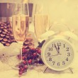 Happy New Year table setting with white retro clock showing five — Stock Photo #51438039