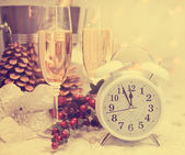 Happy New Year table setting with white retro clock showing five — Stock Photo
