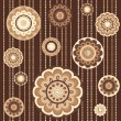 Seamless pattern with abstract flowers in brown — Imagen vectorial