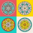 Set of four decorative round elements — Stock Vector