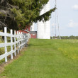Country fence dividing pastures on rural Michigfarm — Stock Photo #28443479