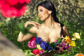 Pretty asian girl with flower cover up body — Stock Photo