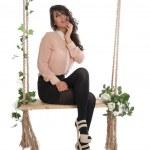 Beautiful woman on a swing — Stock Photo #23737667