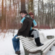 Boy and girl sitting in winter - Stock fotografie