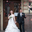 Bride and groom are showered with rose petals — Foto de Stock