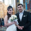 Bride and groom in the church museum — Stock Photo