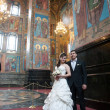 Bride and groom in the church museum — Stock Photo #25338121