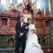 Bride and groom in the church museum — Stock Photo #25338135