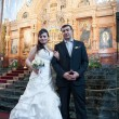 Bride and groom in the church museum — Stock Photo #25338151