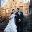 Bride and groom in the church museum — Stock Photo #25338181