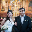 Bride and groom in the church museum — Stock Photo #25338203
