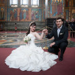 Bride and groom in the church museum — Stock Photo #25338217