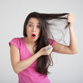 Loss hair comb in women hand — Stock Photo