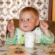 Little boy is drinking at a table — Stock Photo #28850065