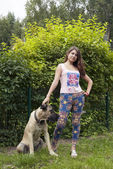 Young woman with a dog — Stock Photo