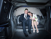 Newlyweds in the limousine — Stock Photo