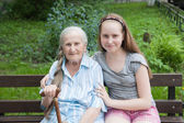 Grandmother with her grandaughter smiling — Stock Photo