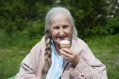 Grandma and ice cream — Stock Photo