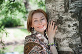 beautiful woman at a tree in summer — Stock Photo