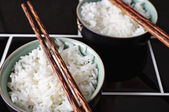 Close up of rice dish and chopsticks — Stock Photo
