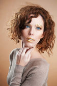 Girl with golden makeup — Stock Photo