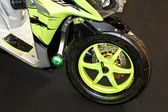 Green motorbike wheel — Stock Photo