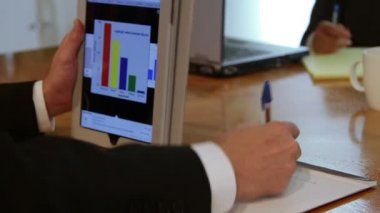 Businessman using a tablet pc — Stock Video